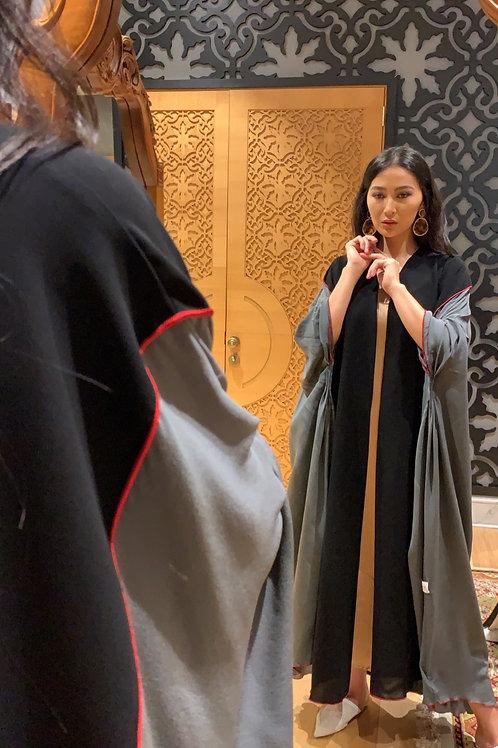 The grey silk pleated abaya with red overlock (Hazm)