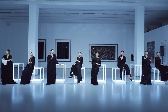 8 models wearing WAAD abayas