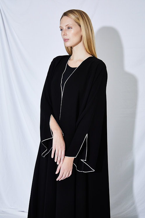 The white overlock trim A-line abaya