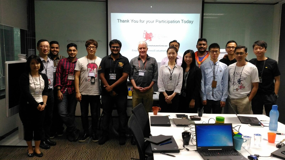 Business Evaluation Centre's Colin Millward with team from SWIFT Malaysia
