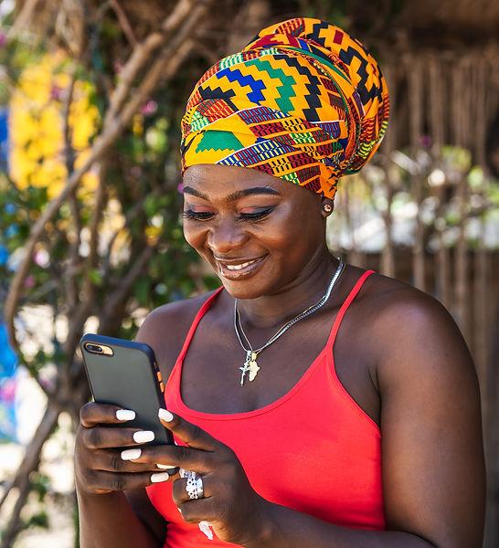 SphereCard black woman looking at phone.