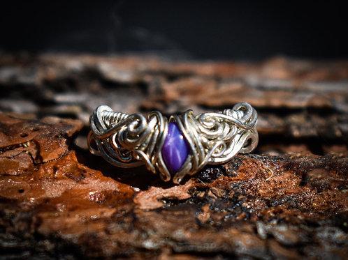Purple star sapphire ring