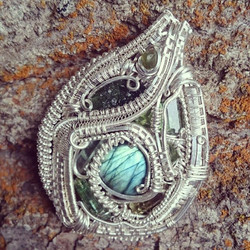 Just finished up this beautiful #medallion piece! #sterlingsilver #wirewrapped #pendant #moldavite #