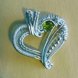 #sterling #silver #wirewrapped #heart #pendant #sterlingsilver #heartshaped #wirewrap #peridot #face