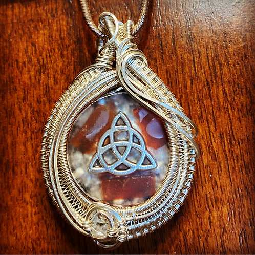 Wirewrapped carnelian orgonite pendant with herkimer