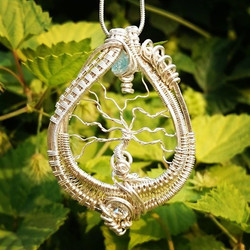 My first attempt at a #treeoflife #pendant #sterling #silver #wirewrap #wirewrappedjewelry #wireart