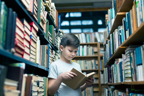 low-angle-boy-library-reading.jpg