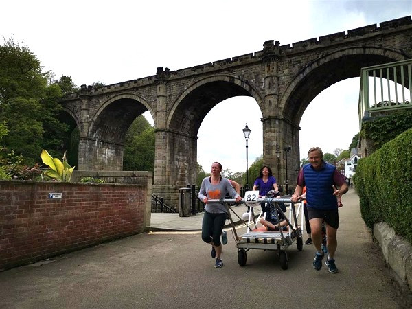 Bed Race team training in Knaresborough with viaduct in background