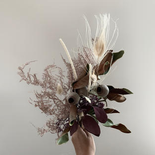 Dry magnolia leaves with assorted dried grasses arrangement