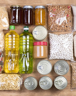Food donations on wooden background, top
