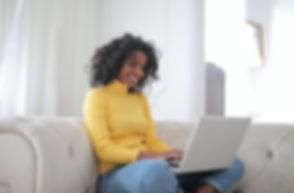 woman-in-yellow-sweater-sitting-on-white
