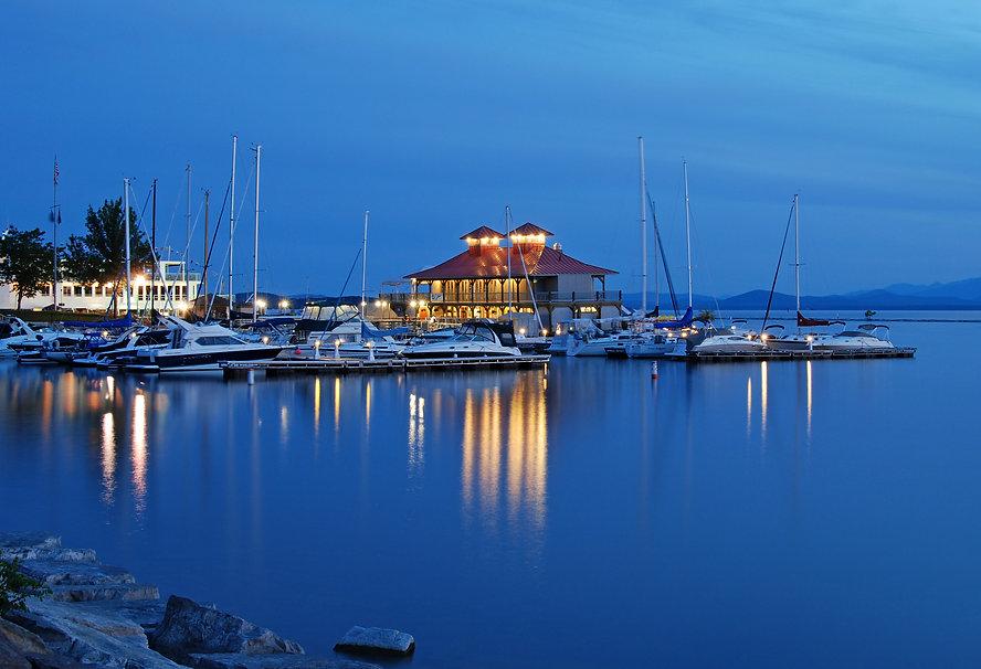 Naimul Karim Naim personal website photography Lake Champlain Vermont dusk aquamarine blue hue lighted boathouse calm water