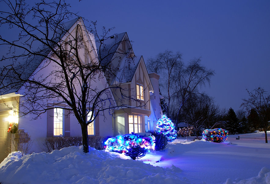 Naimul Karim Naim personal website photgraphy home dusk illuminated window at dusk cold winter Minnesota decorated colorful white snow stucco beautiful house winter evening