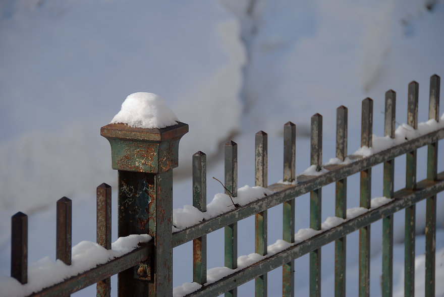 Naimul Karim Naim personal website photgraphy white winter cold Minnesota snow cap on fence post Minehaha Falls Park