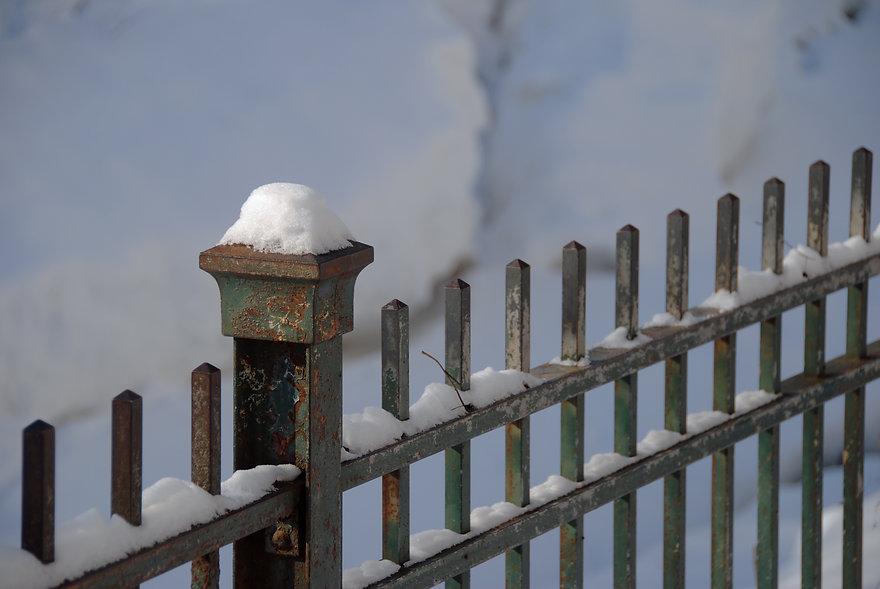 Naimul Karim Naim personal website photgraphy white winter cold Minnesota snow cap on fence post Minehaha Falls Park