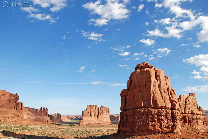 Naimul Karim Naim personal website photography Arches National Park Utah panorama wide sky blue white cloud high noon The Three Gossips