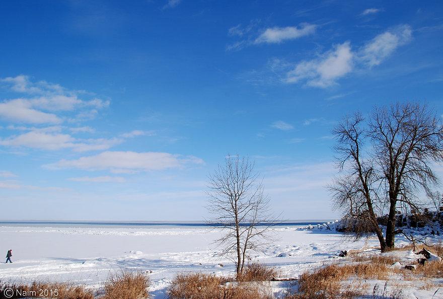 Naimul Karim Naim personal website photgraphy cold witer Minnesota sunny day blue sky man walking on froze water Lake Superior Grand Marais