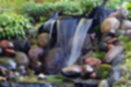 Naimul Karim Naim personal website photgraphy backyard watefall flowing water fountain rocks serene tanquil moss