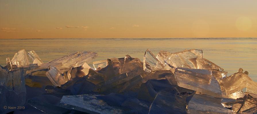 Naimul Karim Naim personal website photgraphy Minnesoata winter frozen blue ice slabs Lake Superior Grand Marais amber ice slab cold winter