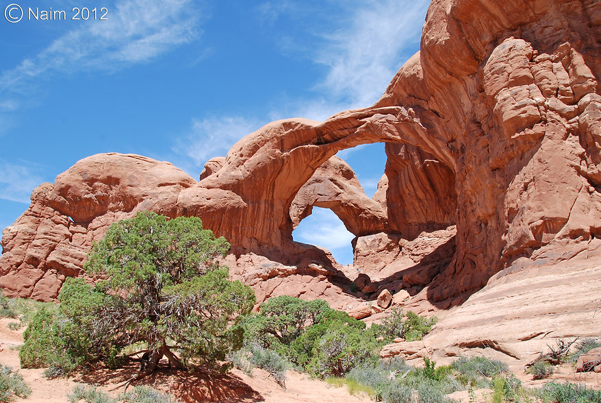 Naimul Karim Naim personal website photography Arches National Park Utah panorama wide sky blue white cloud high noon Double Arch