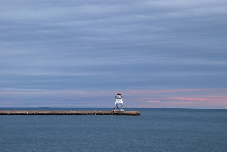 Naimul Karim Naim personal website photgraphy Minnesota Lake Superior Grand Marais overhung sky calm dusk water lighthouse pink sunset