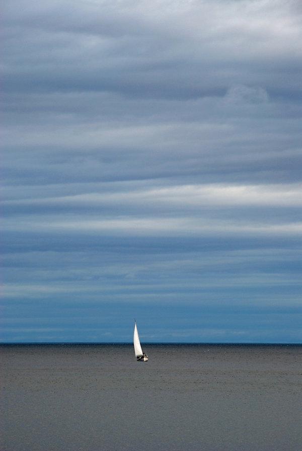 Naimul Karim Naim personal website photgraphy Minnesota Lake Superior Grand Marais overhung sky calm dusk water sailboat