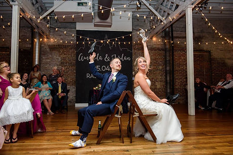 Bride-and-Groom-Playing-Shoe-Game-at-The-Stockroom-at-230-Forever-Bridal-Wedding-Shows.jpg