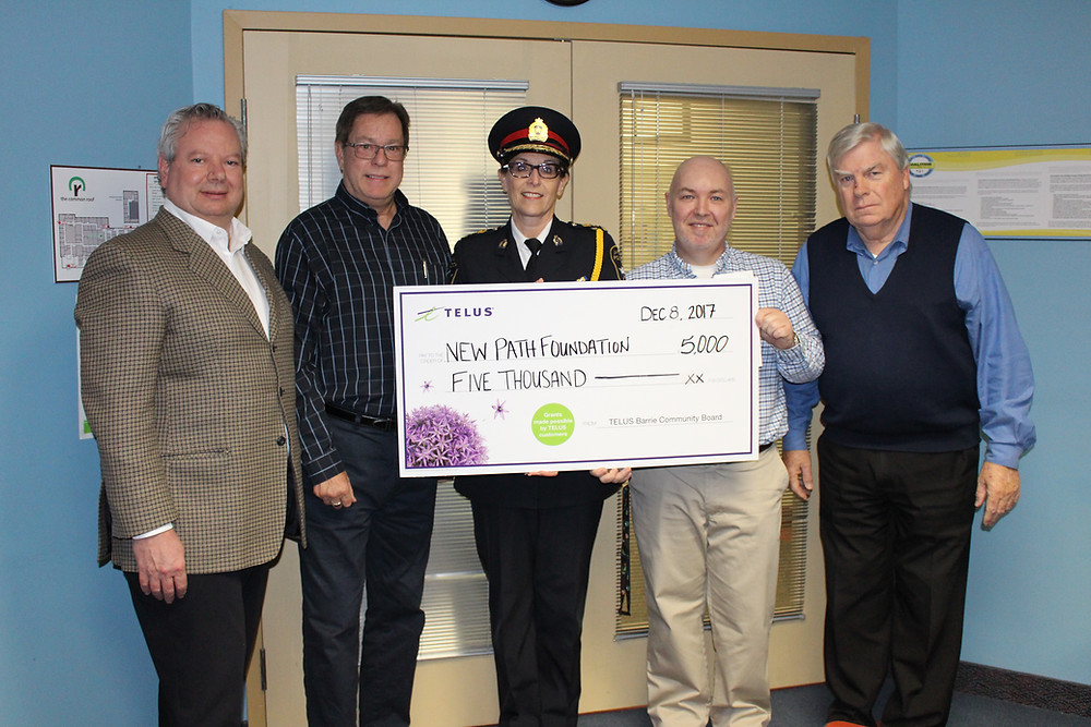 Pictured from left to right are: Jeff Schreiter, New Path Foundation Board Director, Glen Newby, New Path Youth and Family Services CEO, Kimberly Greenwood, Barrie Police Services Chief and TELUS Community Board Grant Review Member, James Thomson, New Path Foundation President and CEO, Bill Macdonald, New Path Foundation Board Chair.