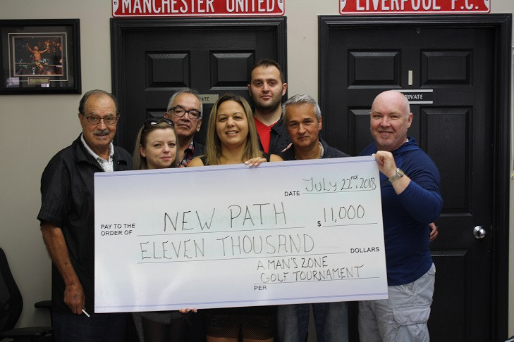 Pictured left to right: Carmen, Kinga, Pepe, Grace, Mike, and Enzo, from A Man's Zone, present a cheque for $11,000 to James Thomson, Vice President of Strategic Initiatives, New Path Foundation. The money raised will go towards the Help The 1 in 5 Fund which helps support child and youth mental health services delivered through New Path Youth and Family Services in Simcoe County.