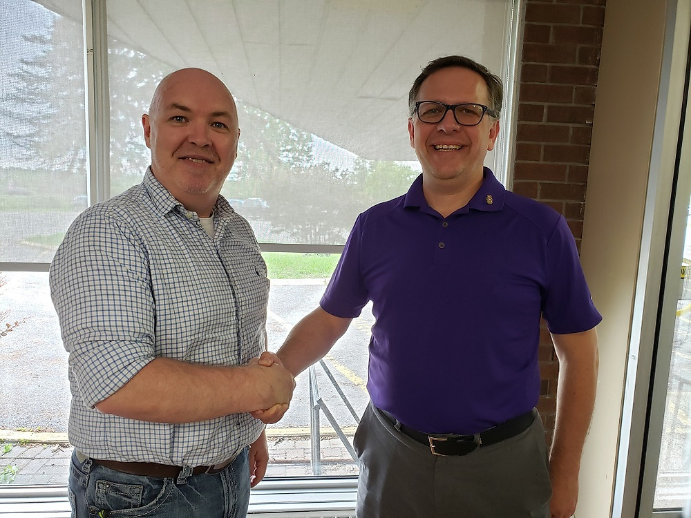 Standing inside the Collingwood Common Roof™ and Rotary Hub (left to right) James Thomson, President and CEO, New Path Foundation and James Saunders, President of the Rotary Club of Collingwood.