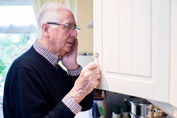 Dementia looking in cupboard.jpg