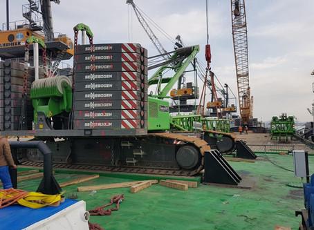 Loading a crane onto a barge
