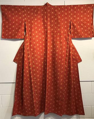 Japanese summer kimono with an ikat geometric design on burnt orange fabric