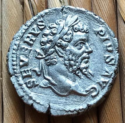 Roman silver coin (denarius) issued by the emperor Septimius Severus, 207 AD.