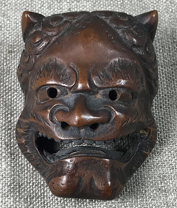 Japanese netsuke in the form of an Oni mask