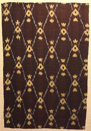 Japanese kasuri (ikat) fragment mounted on linen – diamond motifs