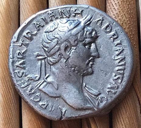 Roman silver coin (denarius) issued by the Emperor Hadrian, 117 - 138 AD.