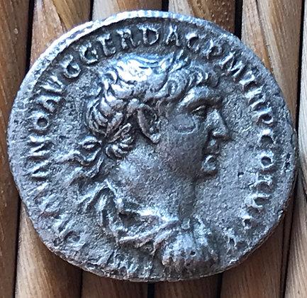 Roman silver coin (denarius) issued by the Emperor Trajan, 98 - 117 AD.