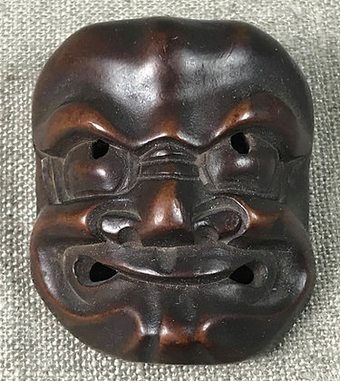 Japanese netsuke in the form of a Beshimi mask