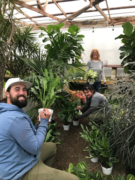 Taylor, Steve and Jen in the Greenhouse.