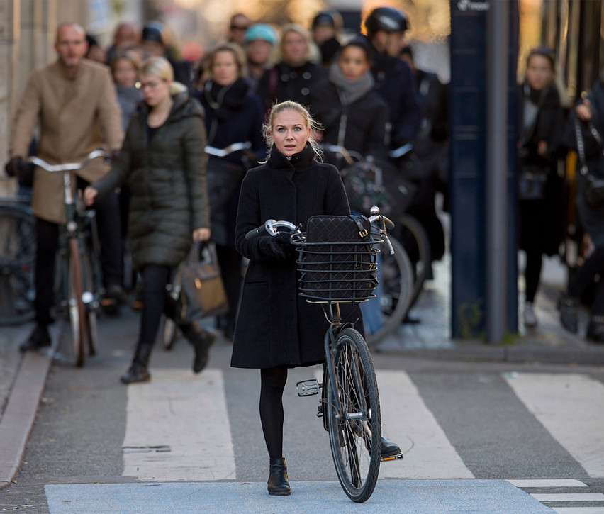 Stylishly leading the fashion pack, from a bicycle