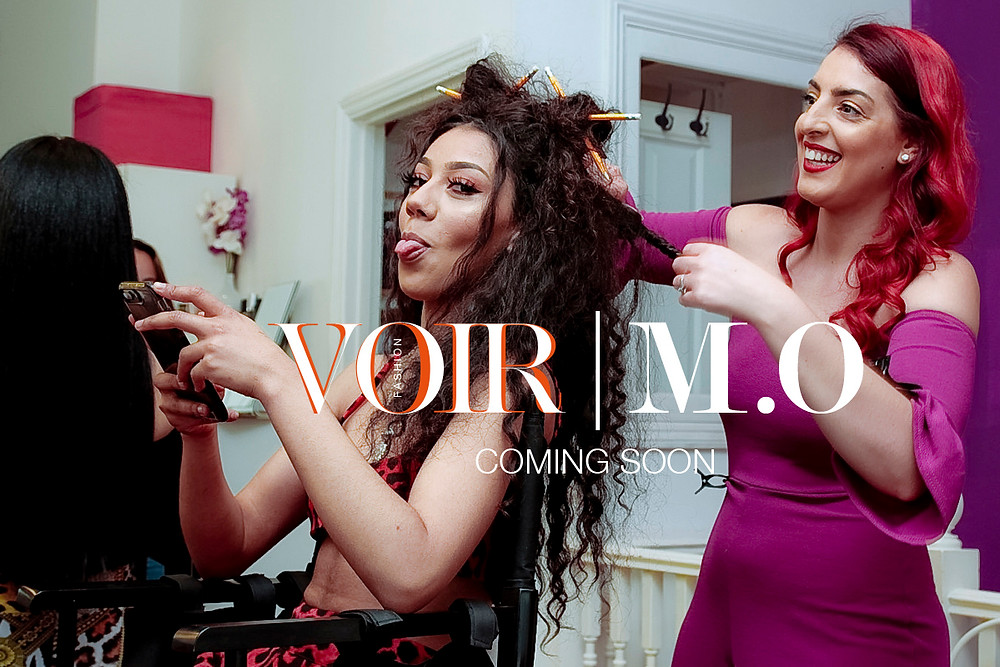 Kymberley styles the hair of Chanal [M.O] backstage at the Voir | M.O collaboration