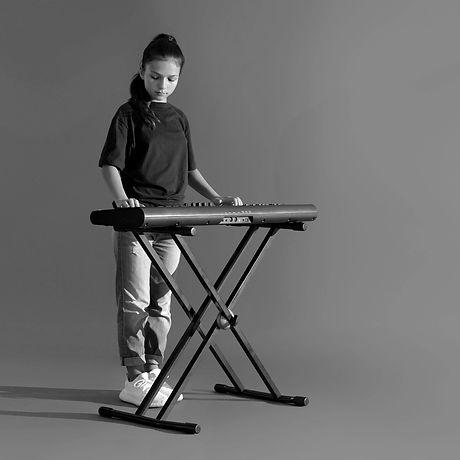 Girl with Piano_edited_edited.jpg