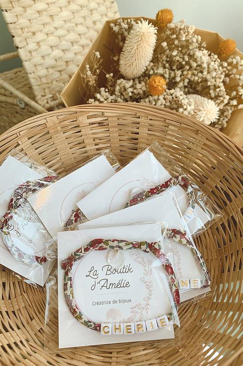 Bracelet cordon Liberty fleuri blanc/fuchsia - La Boutik d'Amélie