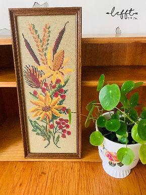 Lijst met geborduurde bloemen