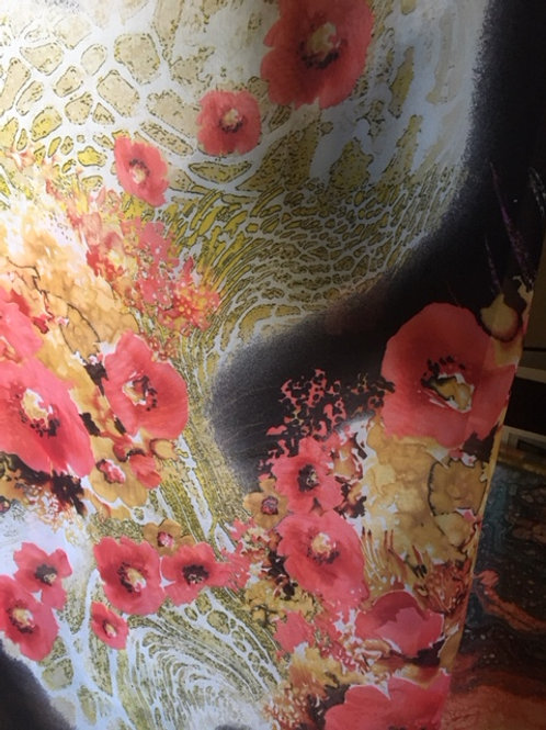 Chiffon fabric has a black background with peach and white flowers.
