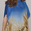 Thumbnail: Chiffon fabric with a large scale abstract design in blue, caramel and black