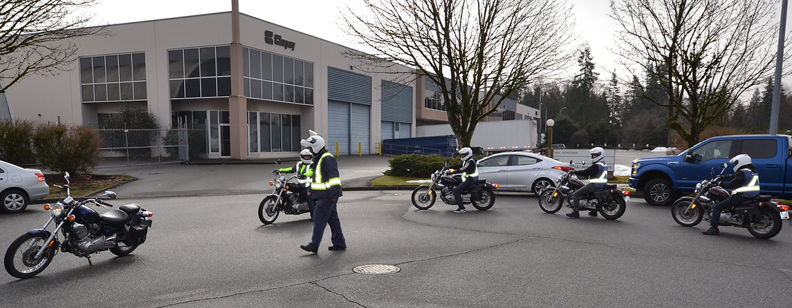 Motorcycle Instructor Teaching Students