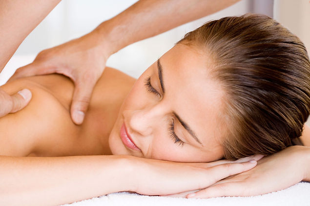 massaging back of a girl
