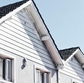 地主參與都市更新權利變換取得之房屋,應以所有權移轉登記日為取得日